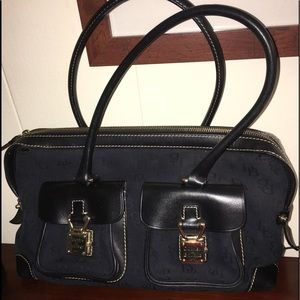 Dooney & Bourke black leather and fabric satchel.